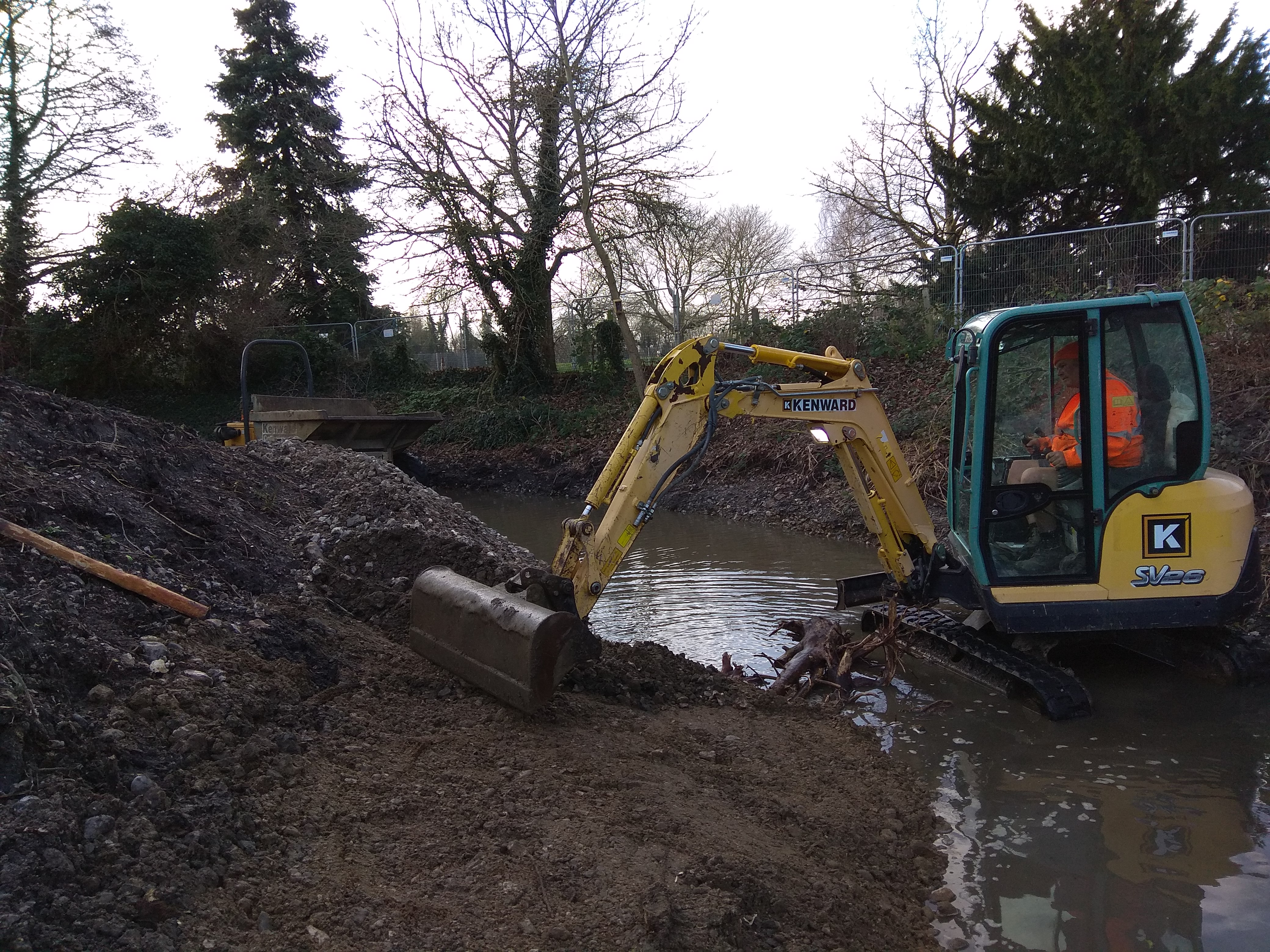 The stockpiled gravel being reused in front of the retained silt to provide a gently sloping inside bend