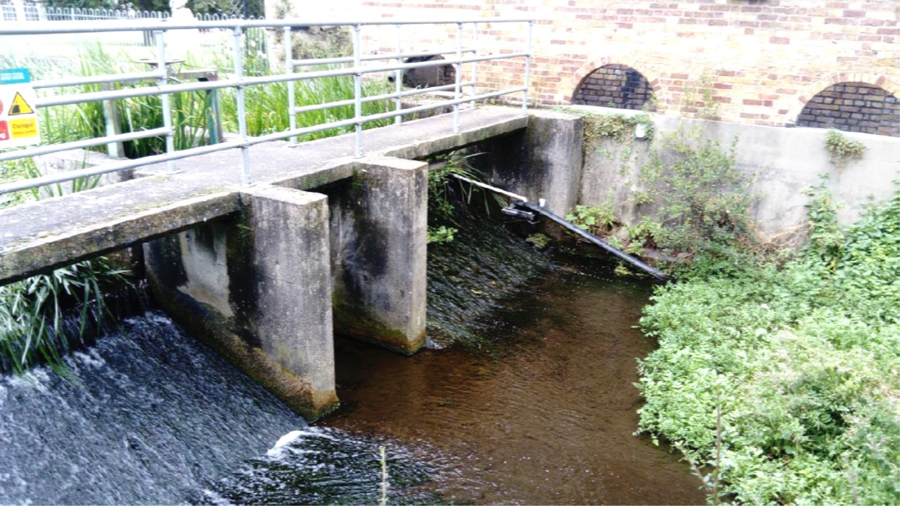 Acacia Hall weir - impounding the upstream channel, promoting silt deposition and preventing fish migration.